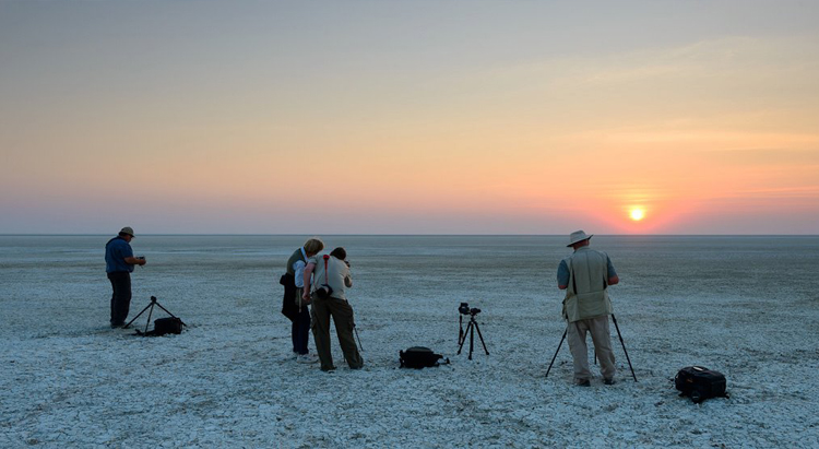 Out Guides Helping to shoot a sun set